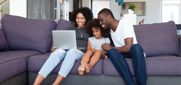 family browsing on laptop together