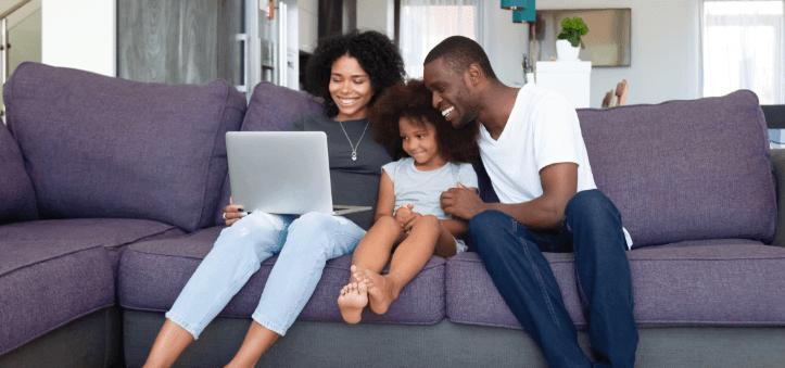 family browsing on laptop