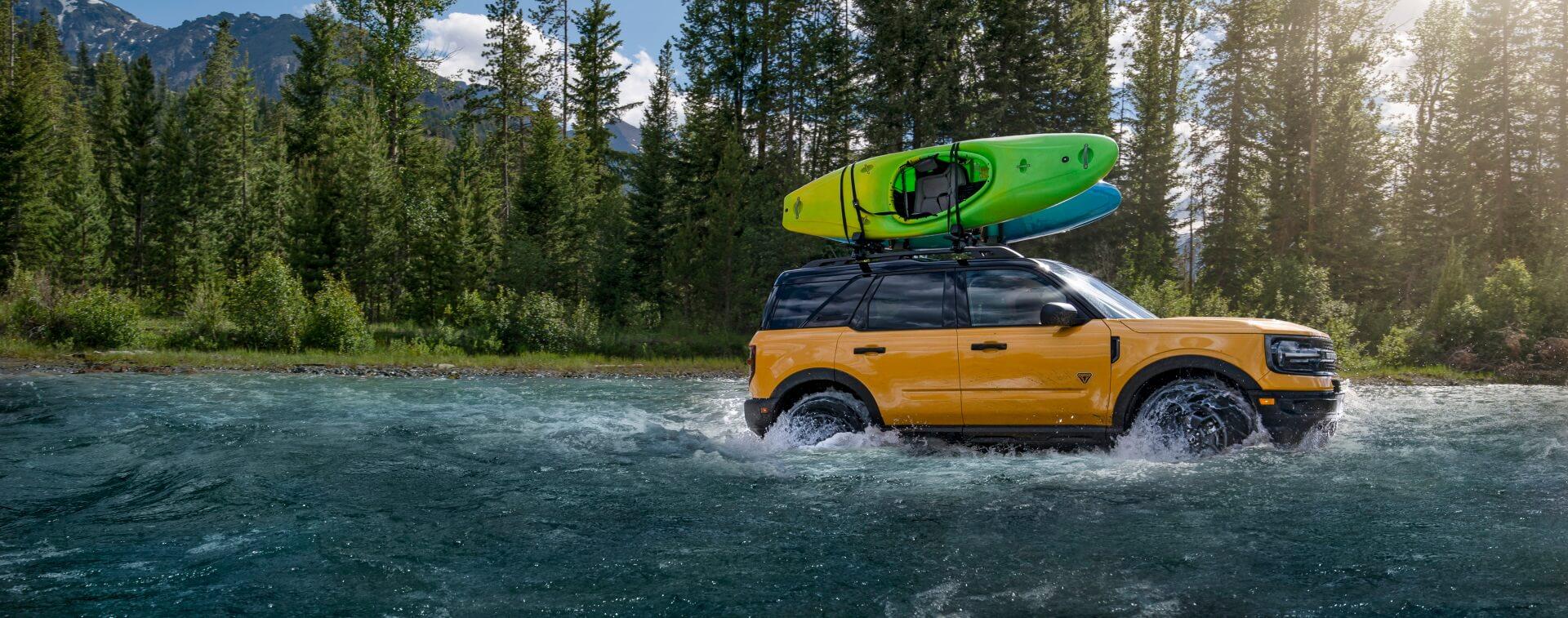 sports vehicle splashing through water